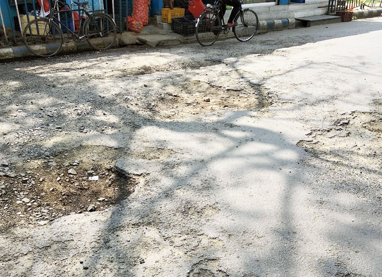 A cratered road in LB Block
