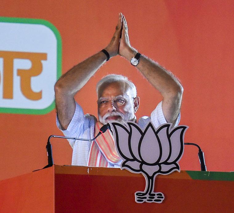 Prime Minister Narendra Modi addressing an election rally at Ramlila Maidan in New Delhi on Wednesday.