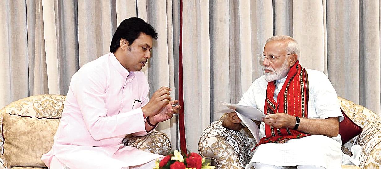 Biplab Kumar Deb interacts with Narendra Modi in New Delhi.