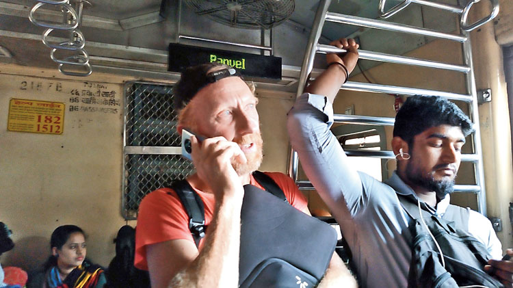Peter Van Geit (left) in a Mumbai local train