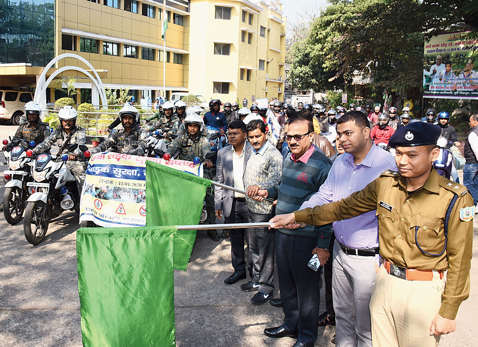 Ravi Shankar Shukla (in purple) flags off a road safety awareness van at the district collectorate in Jamshedpur on Tuesday