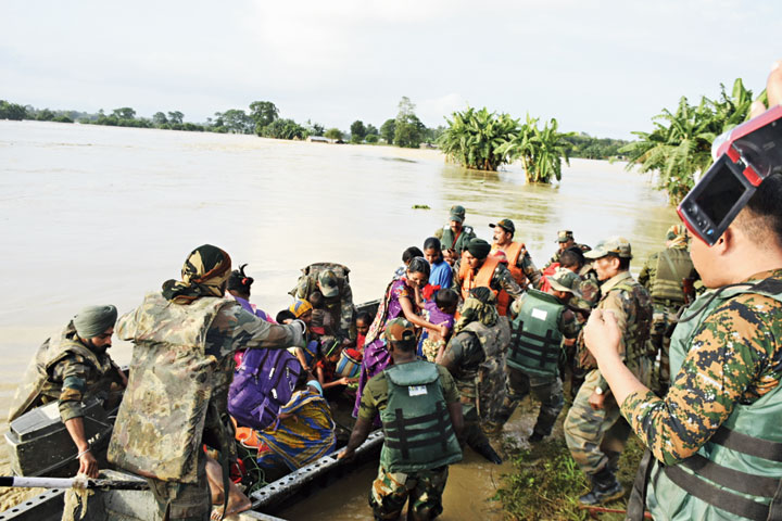Army and Assam Rifles personnel evacuate stranded persons from Ekhyo Yan village on Sunday