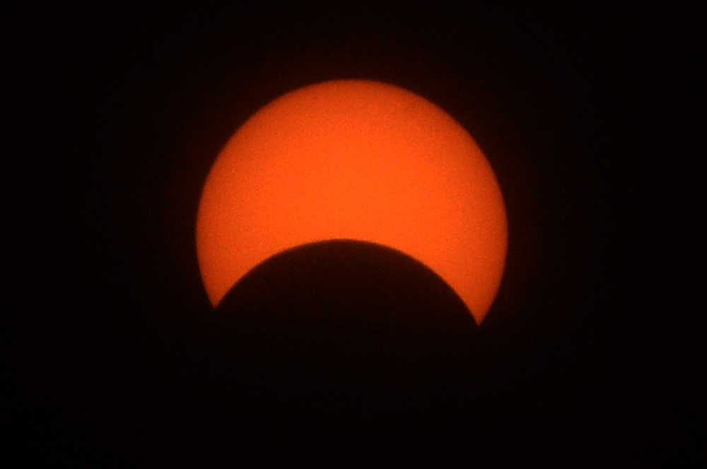 A view of the partial solar eclipse as seen from Surat on December 26