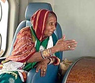 Pramila Bishoyi in Naveen Patnaik's helicopter during the campaign.