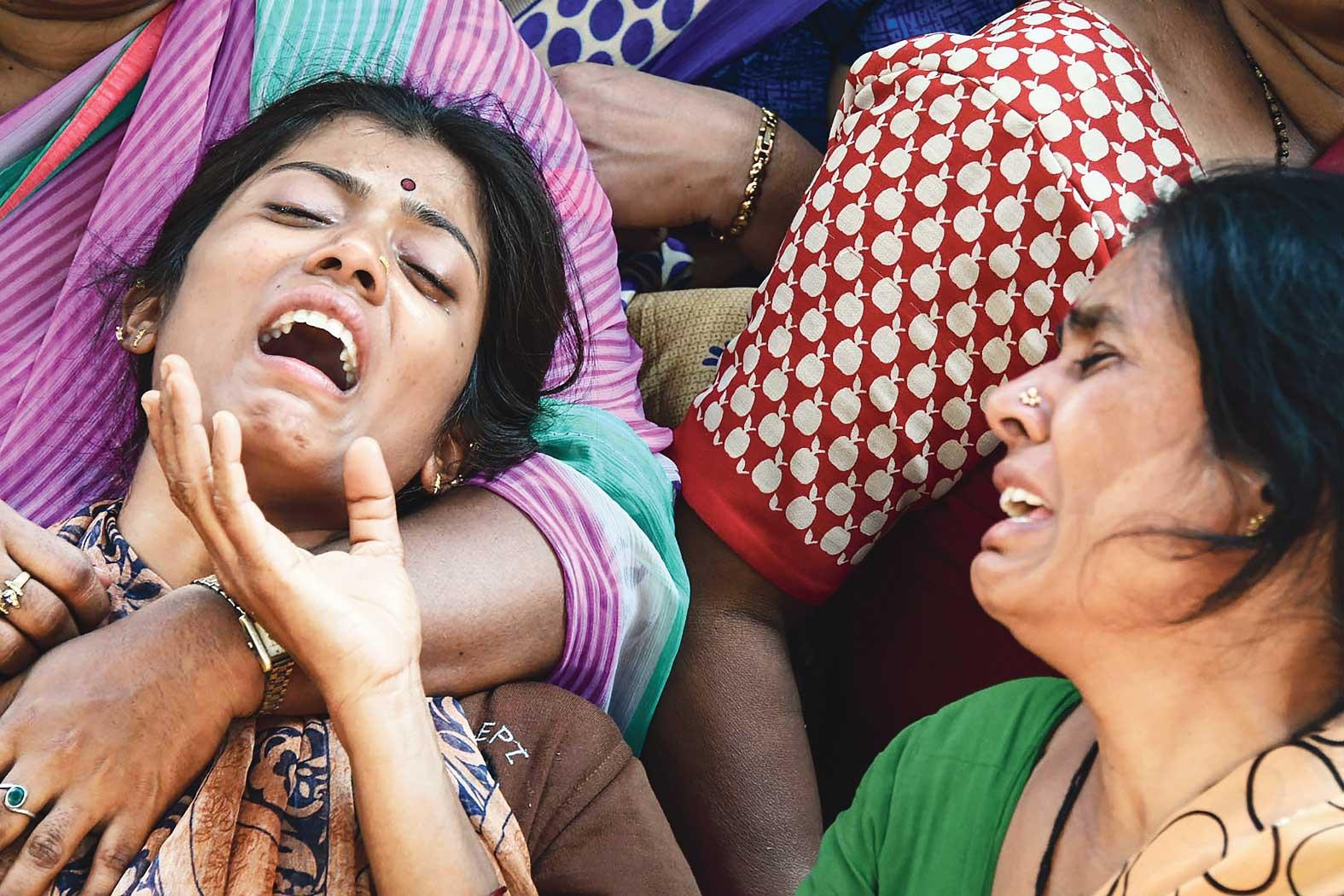 Guru H's family mourns at their home in Doddi village of Mandya district, Karnataka.
