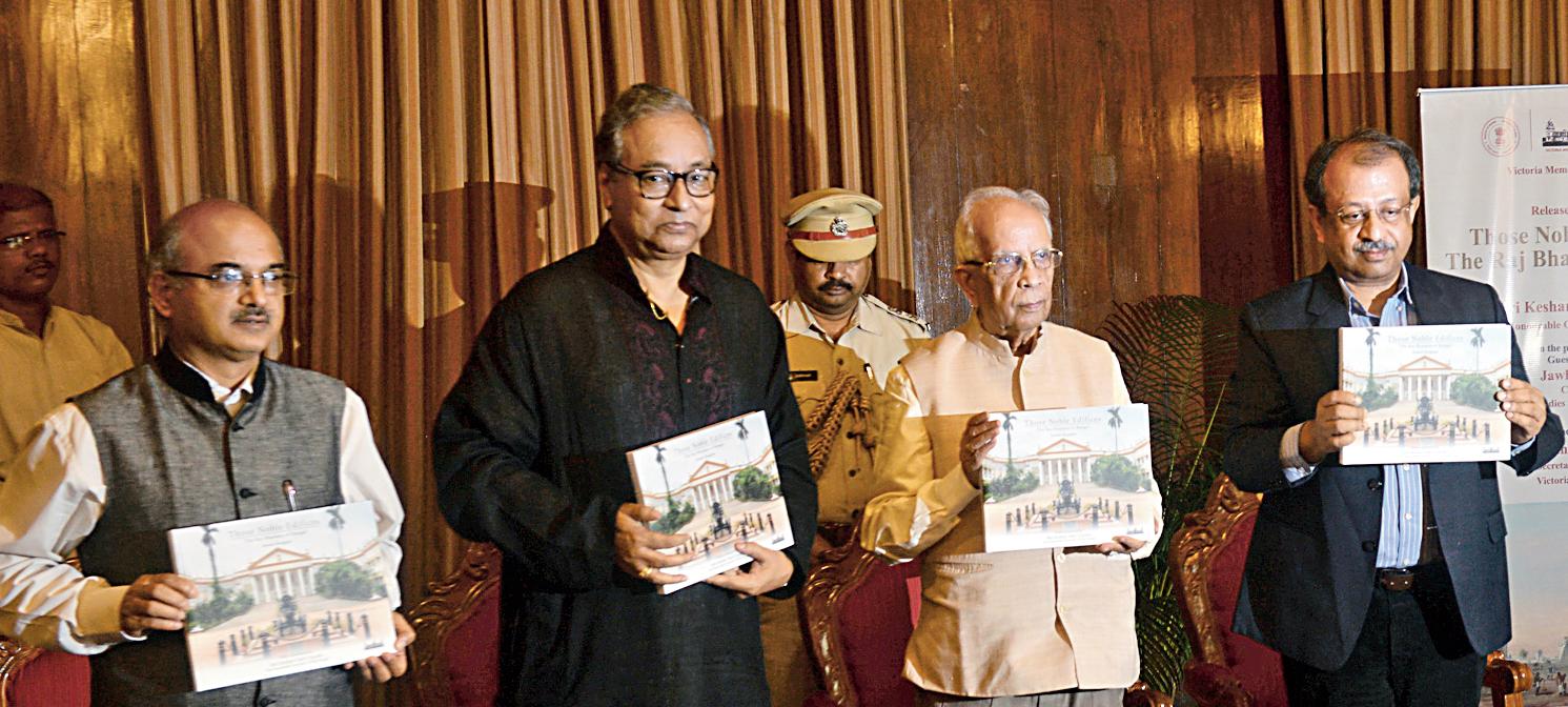 Satish Tewary, the additional chief secretary to the governor, Jawhar Sircar, governor Keshari Nath Tripathi and author Jayanta Sengupta at the book launch at Raj Bhavan on Thursday.