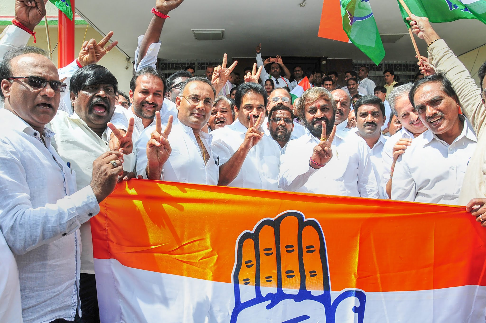 Congress leaders celebrate in Bengaluru after the bypoll victories on Tuesday.
