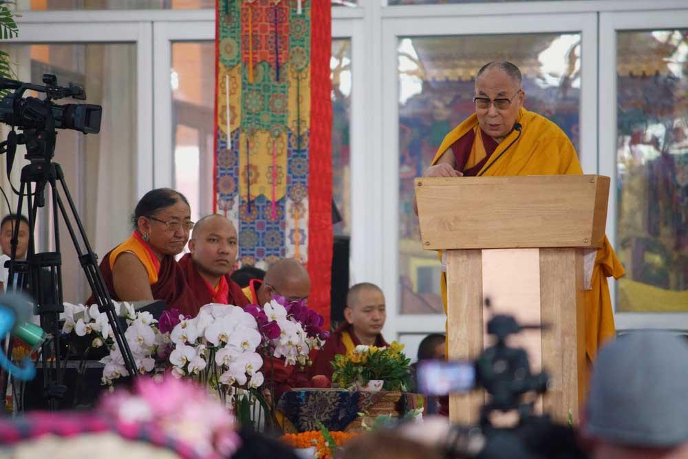 The Dalai Lama and the 17th Gyalwang Karmapa, Ogyen Trinley Dorje (in the background), share the stage at the Kalachakra festival, 2017, in Bodh Gaya, Bihar.