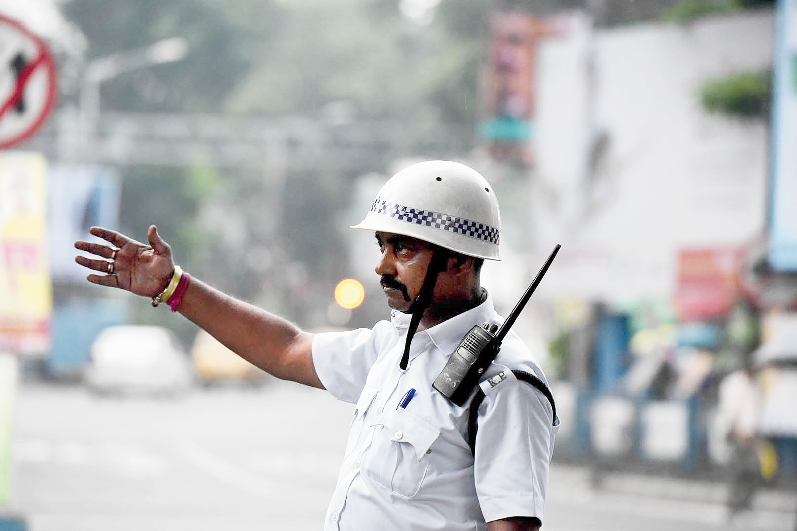 Constable Arup Mukherjee manages traffic at an intersection in the city.