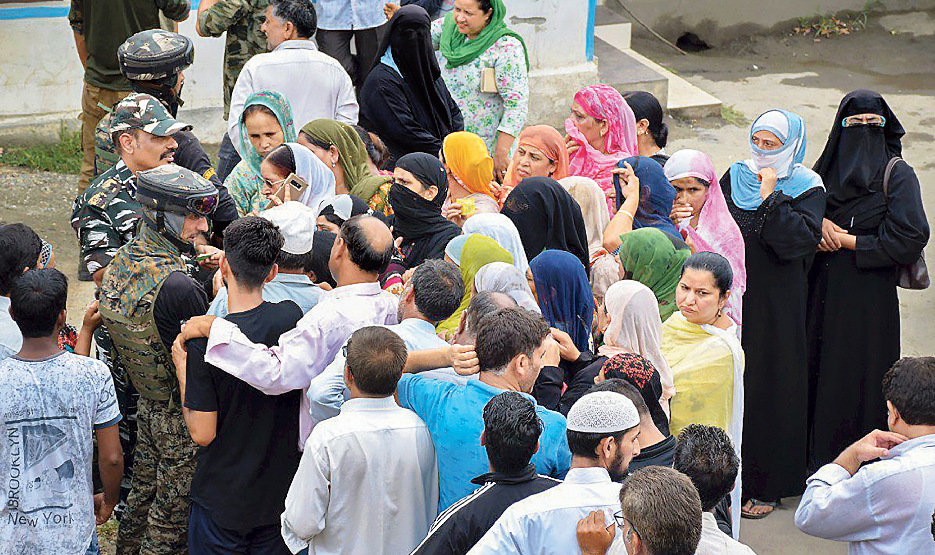 GOVERNMENT PICTURE: A picture tweeted by the home ministry on Sunday morning shows security forces and the civil administration helping people connect with their relatives over the phone in the Kashmir Valley.
