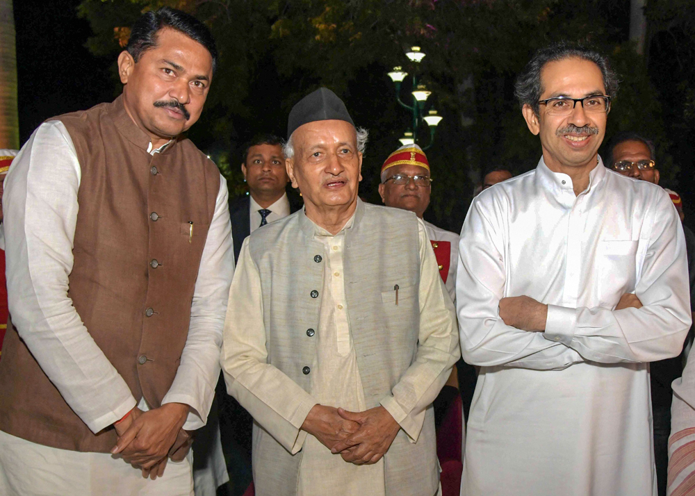 Maharashtra governor Bhagat Singh Koshiyari, chief minister Uddhav Thackeray and Assembly Speaker Nana Patole at a dinner at Raj Bhavan in Nagpur on December 19