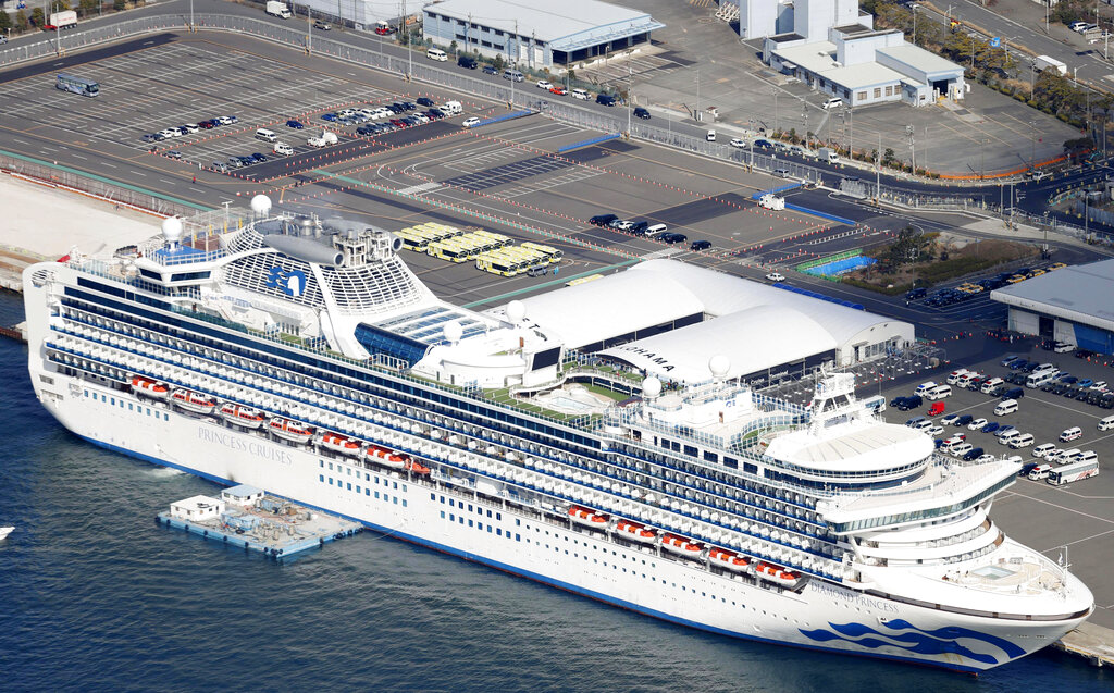 The quarantined Diamond Princess cruise ship is anchored at a port in Yokohama, near Tokyo on Wednesday