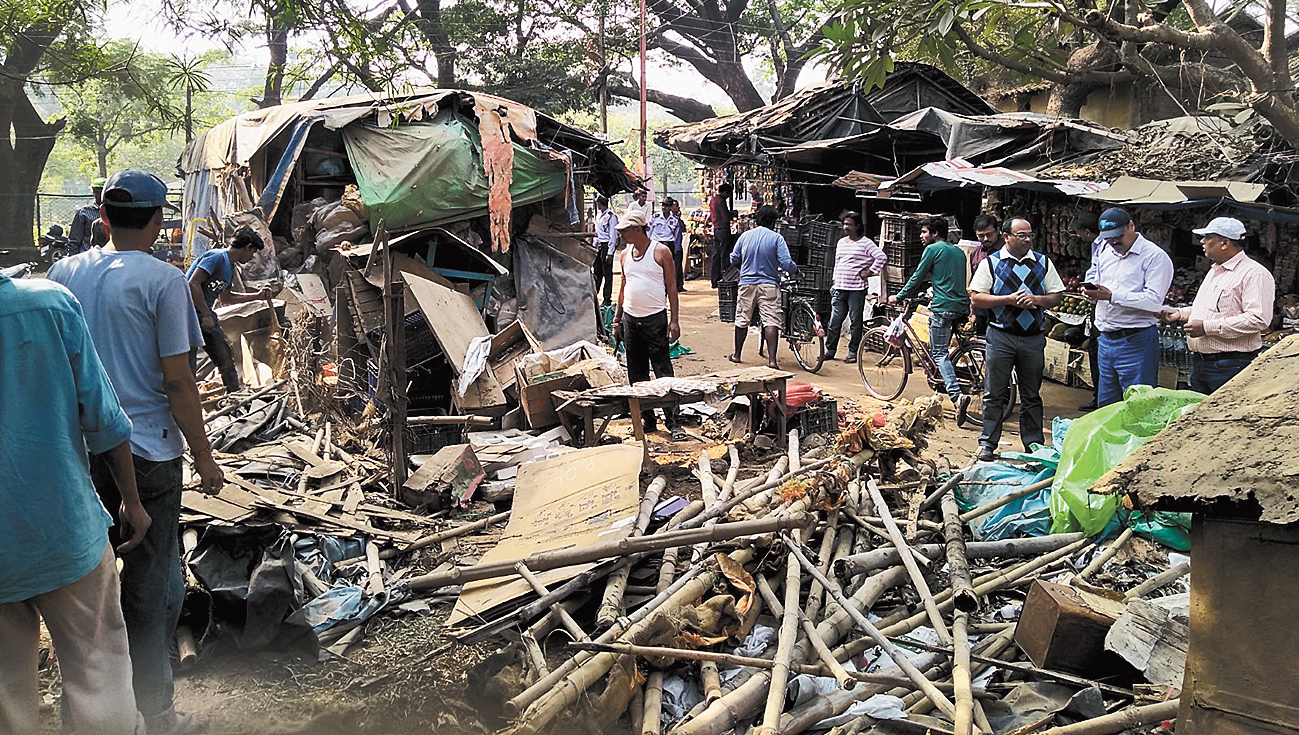 Illegal stalls being demolished on the Visva-Bharati campus on Sunday.