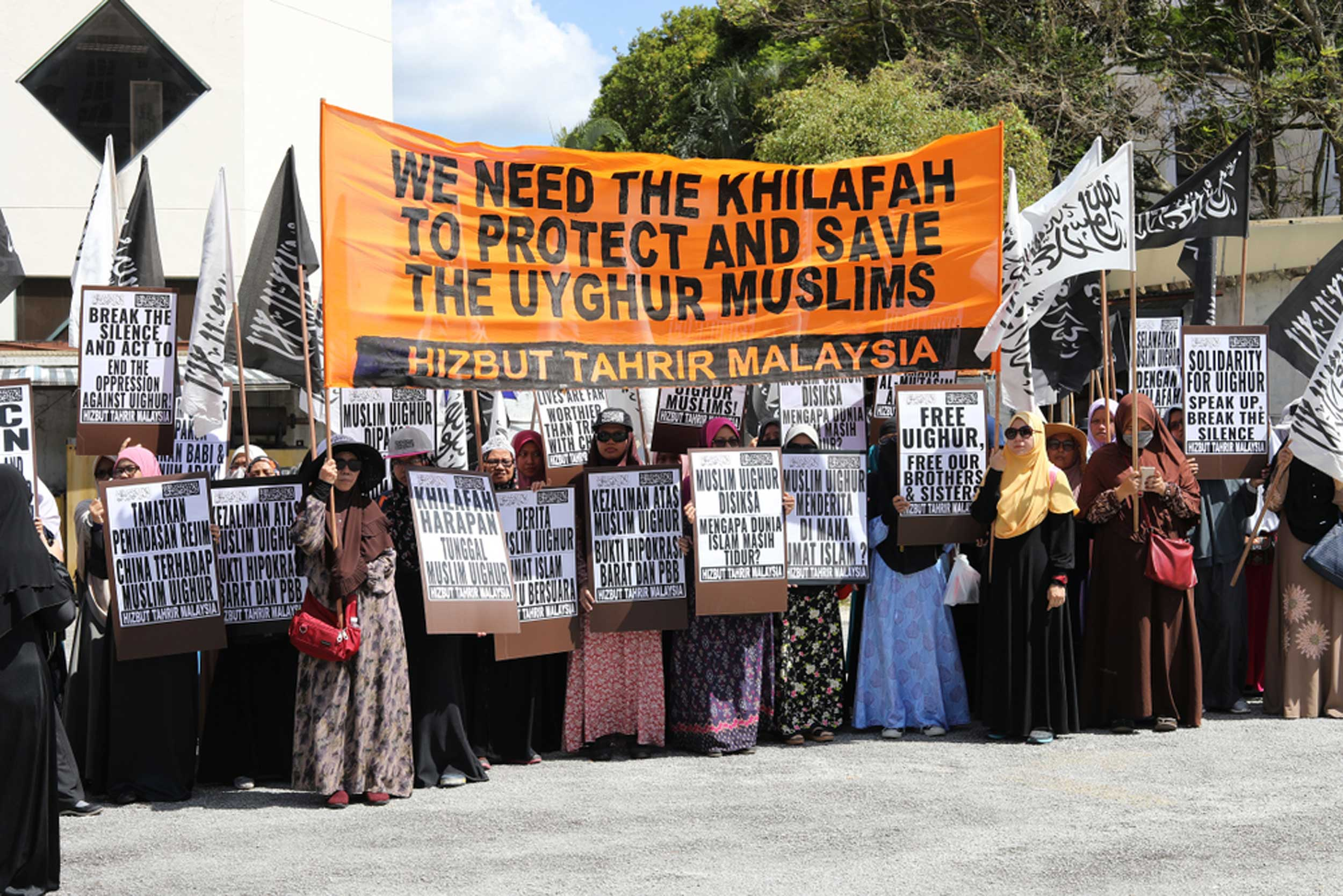 Malaysian women hold banners in support of Uighur Muslims in Chinese detention and political indoctrination centres, in Kuala Lumpur, on December 11, 2018.