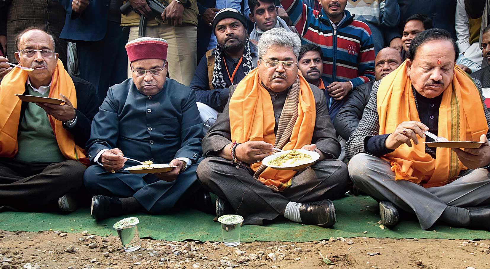 Union ministers Vijay Goel, Thaawar Chand Gehlot, Harsh Vardhan and others eat khichdi in New Delhi on Sunday.