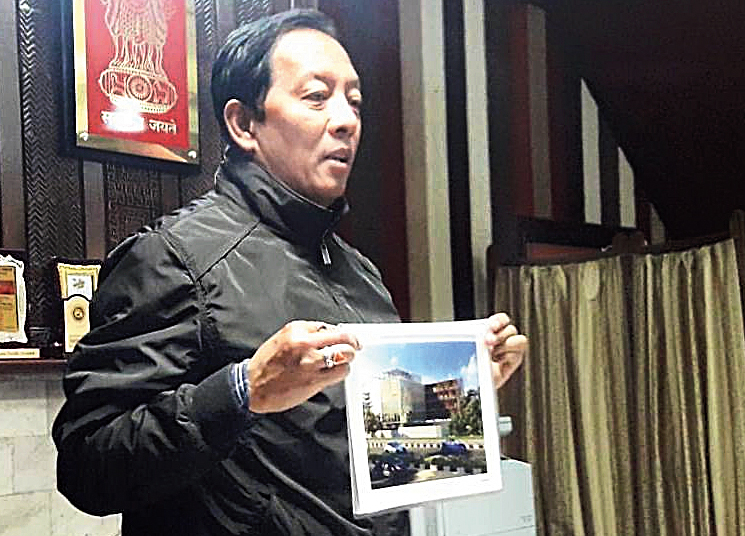 Tamang shows the plan of one of the construction projects in Darjeeling on Friday.