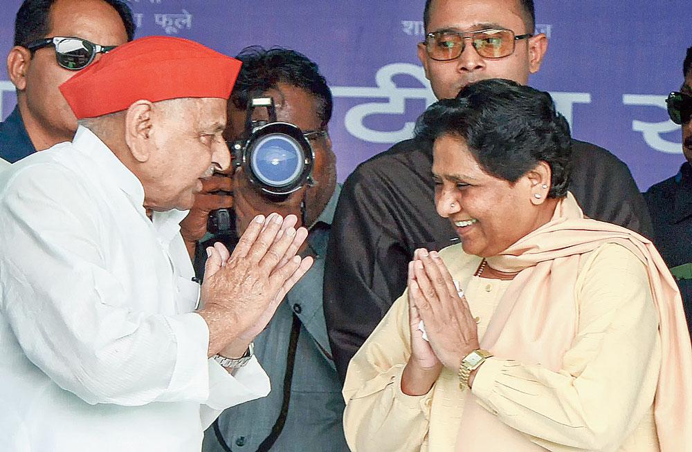 Mulayam Singh greets Mayawati at the rally in Mainpuri, Uttar Pradesh, on Friday