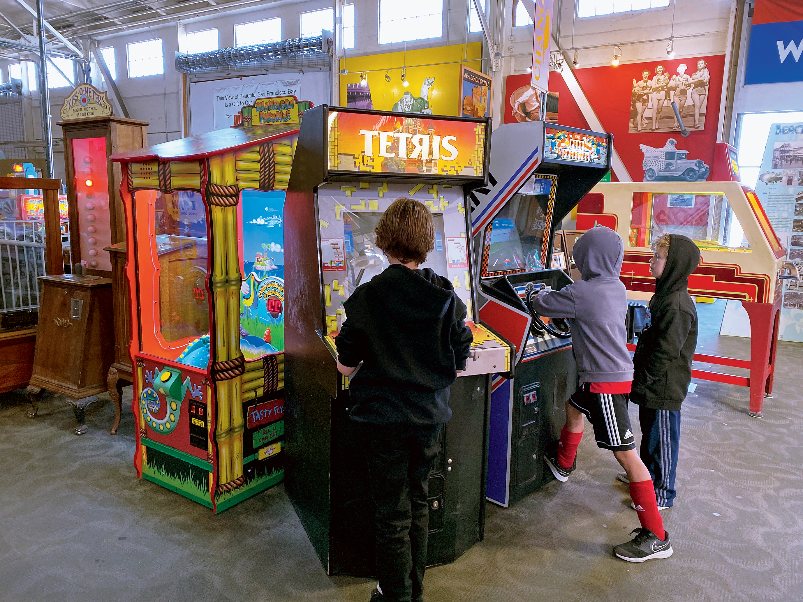Kids spend a Monday afternoon at Musee Mecanique in San Francisco.