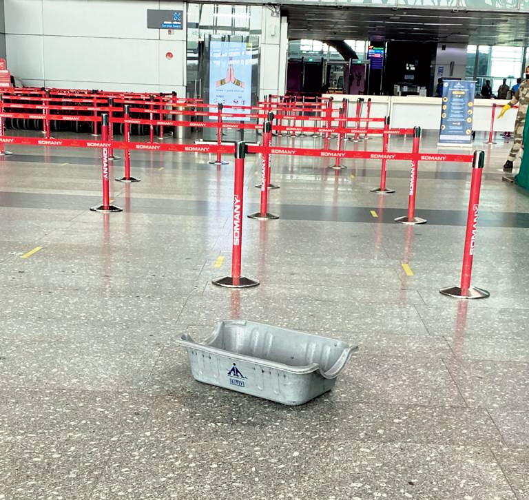 A tub placed inside the airport on Thursday to collect rainwater dripping from the roof