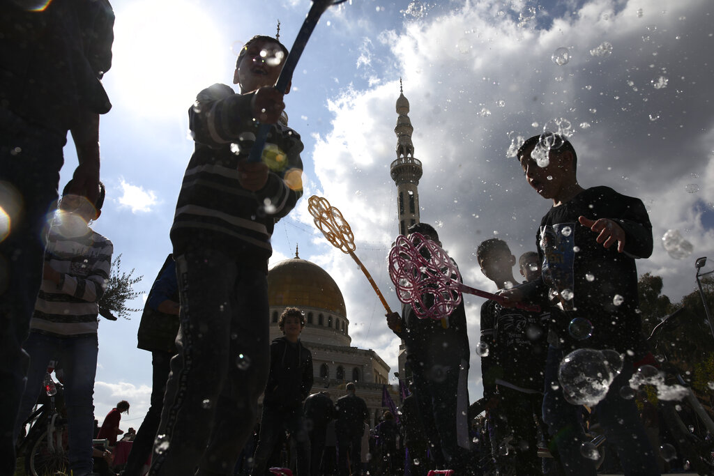 Israeli Arab kids play with soap bubbles during a protest against U.S. President Donald Trump's Mideast initiative, in the Israeli Arab town of Jaljulia, Israel