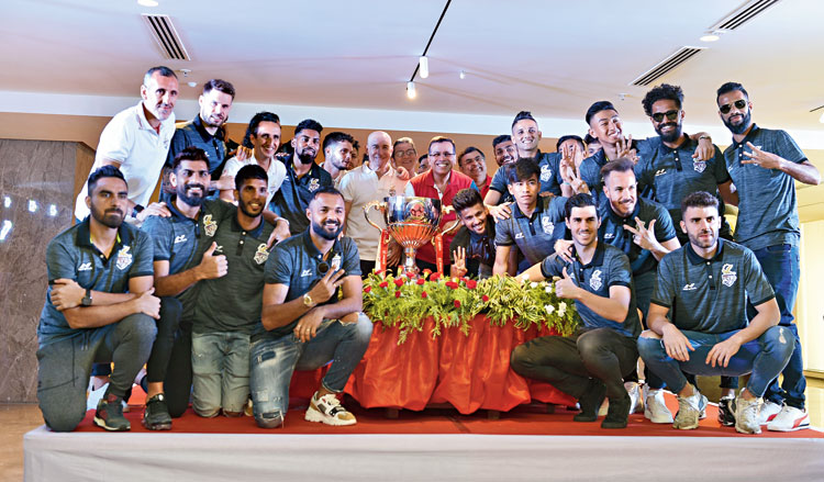 ATK principal owner Sanjiv Goenka (centre) with coach Antonio Lopez, players and rest of the support staff during a felicitation in the city on Sunday