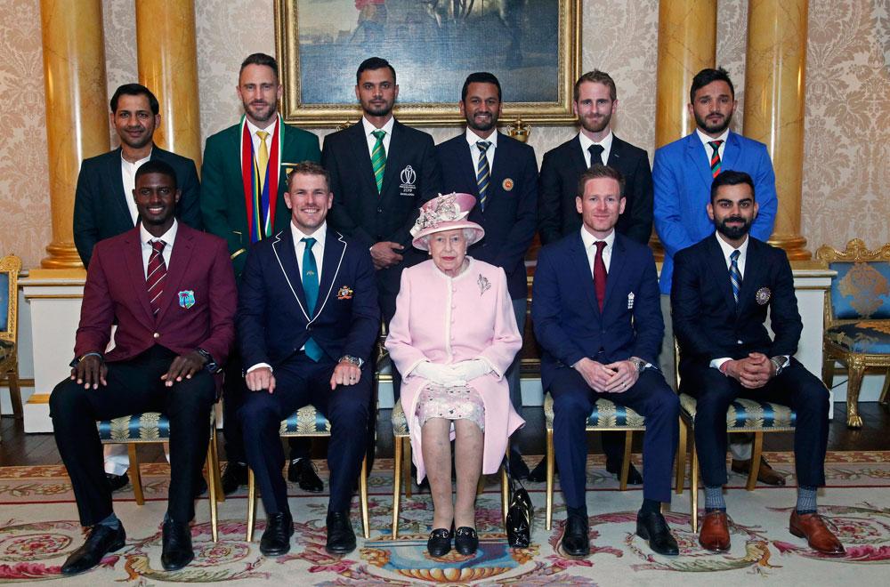 Britain's Queen Elizabeth with the captains of the 10 teams participating in the World Cup, at Buckingham Palace, in London, on Wednesday