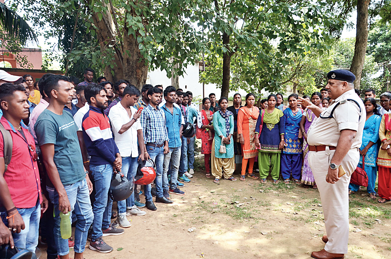 Youths selected as home guards demand training at the home guard office in Harmu in Ranchi on Monday.