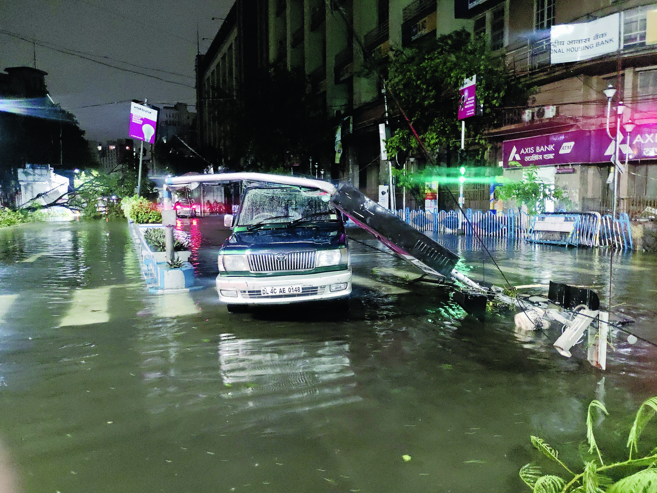 A car on Central Avenue stuck by the after-effects of Cyclone Amphan on Wednesday evening.