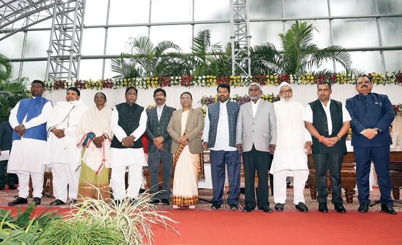 (From left) Satyanand Bhokta, Badal Patralekh, Joba Manjhi, Alamgir Alam, Hemant Soren, governor Droupadi Murmu, Jagannath Mahto, Champai Soren, Haji Hussain Ansari, Banna Gupta and Mithilesh Kumar Thakur at Raj Bhavan in Ranchi on Tuesday.