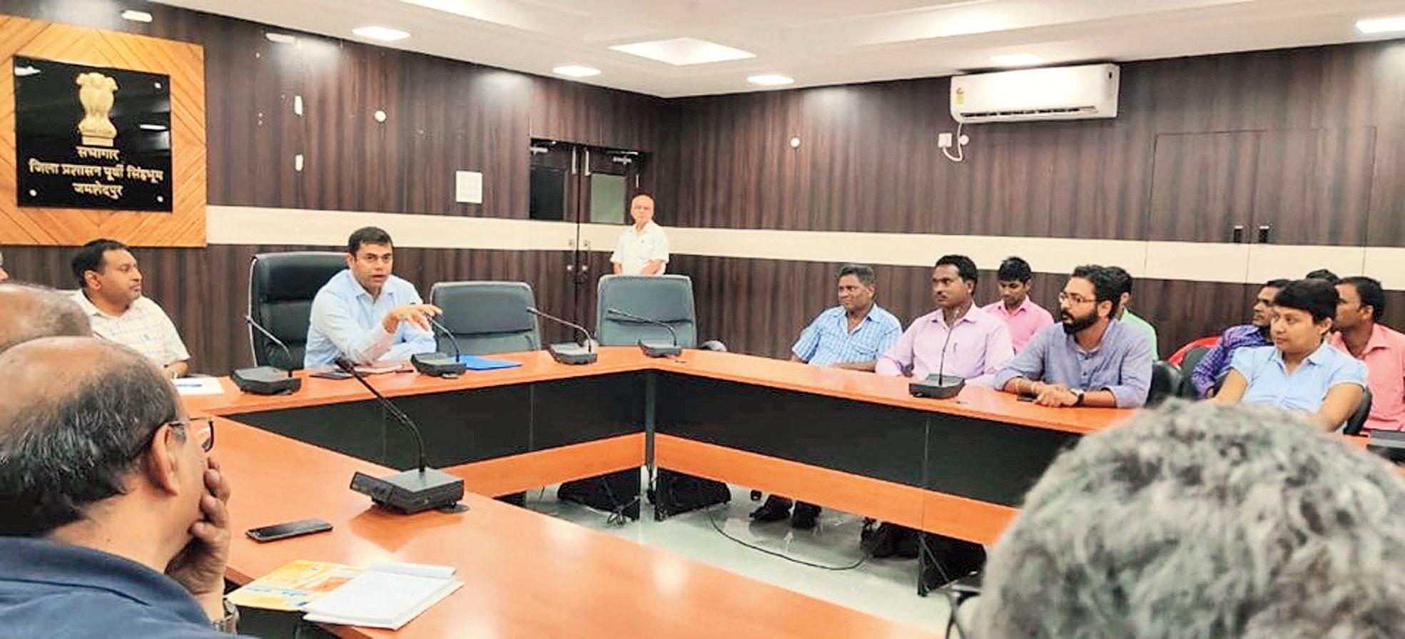 Deputy commissioner Ravi Shankar Shukla (left) addresses the meeting in Jamshedpur on Thursday.