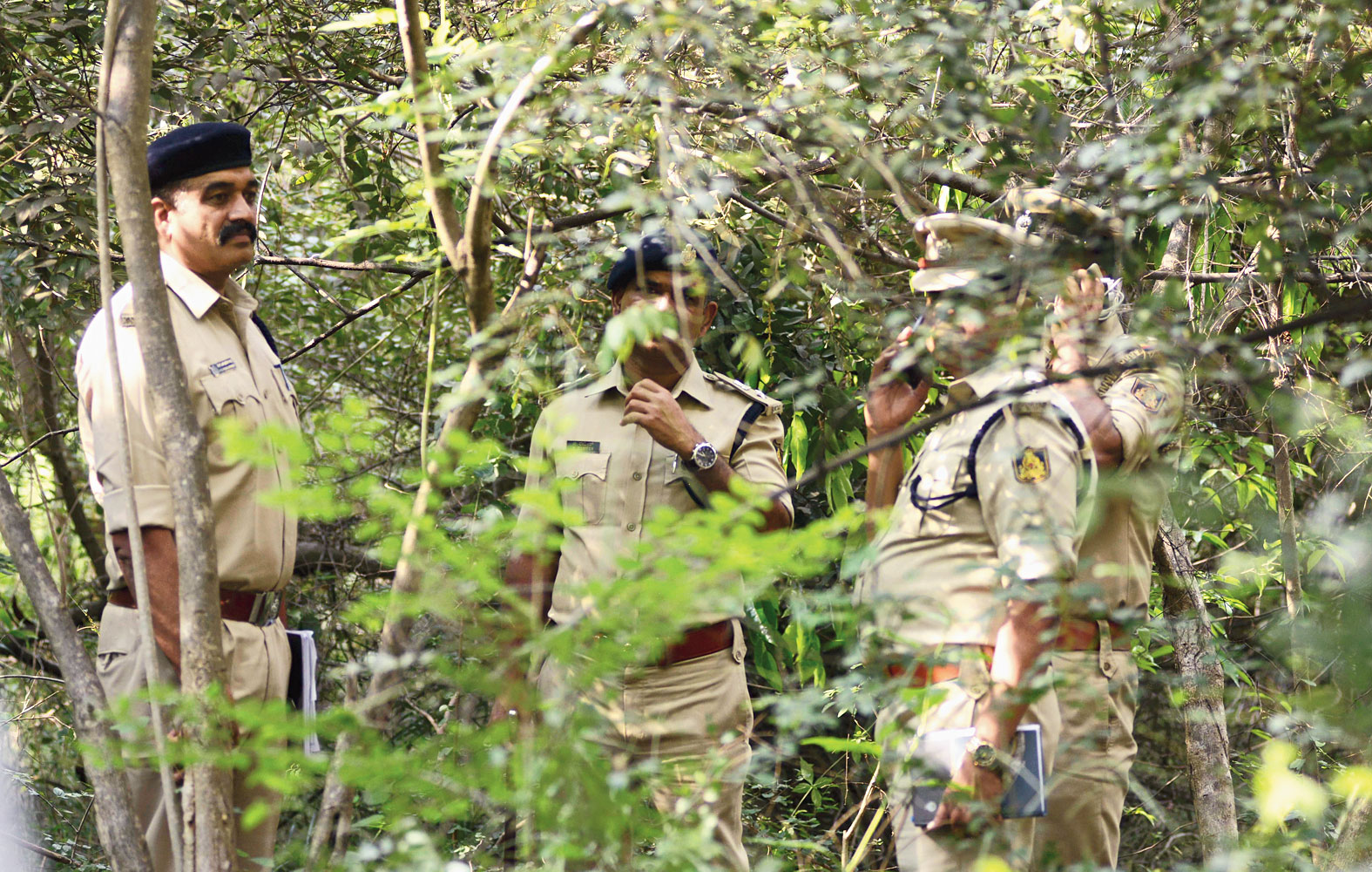 Police officers near the spot where Ramesh's body was found on Saturday.