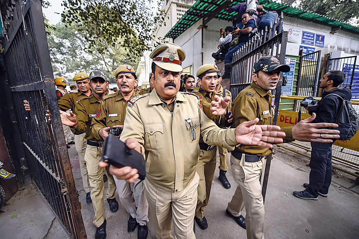 Police clear the way at the complex housing the Patiala House Courts where Michel was produced on Wednesday