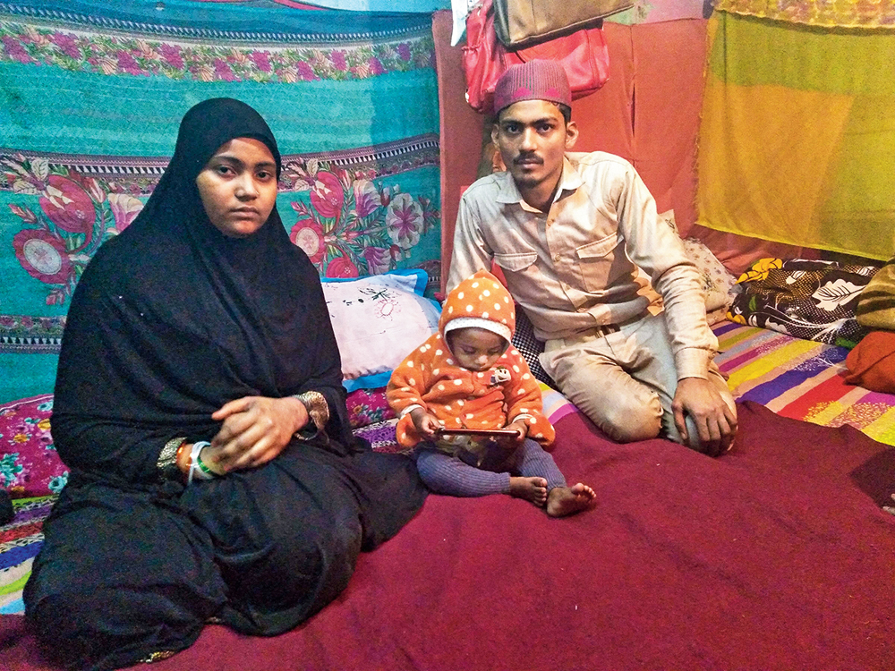 Mohammed Arif and Nazia with one of their children at their residence in Batla House, New Delhi, on Monday