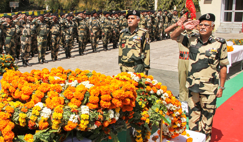 BSF Director General Rajni Kant Mishra pays tribute to slain police Inspector T. Alex Lalminlun during a wreath-laying ceremony in Jammu on Tuesday, April 02, 2019. Lalminlun was killed during a ceasefire violation by Pakistani troops along the Line of Control in Poonch district of Jammu.