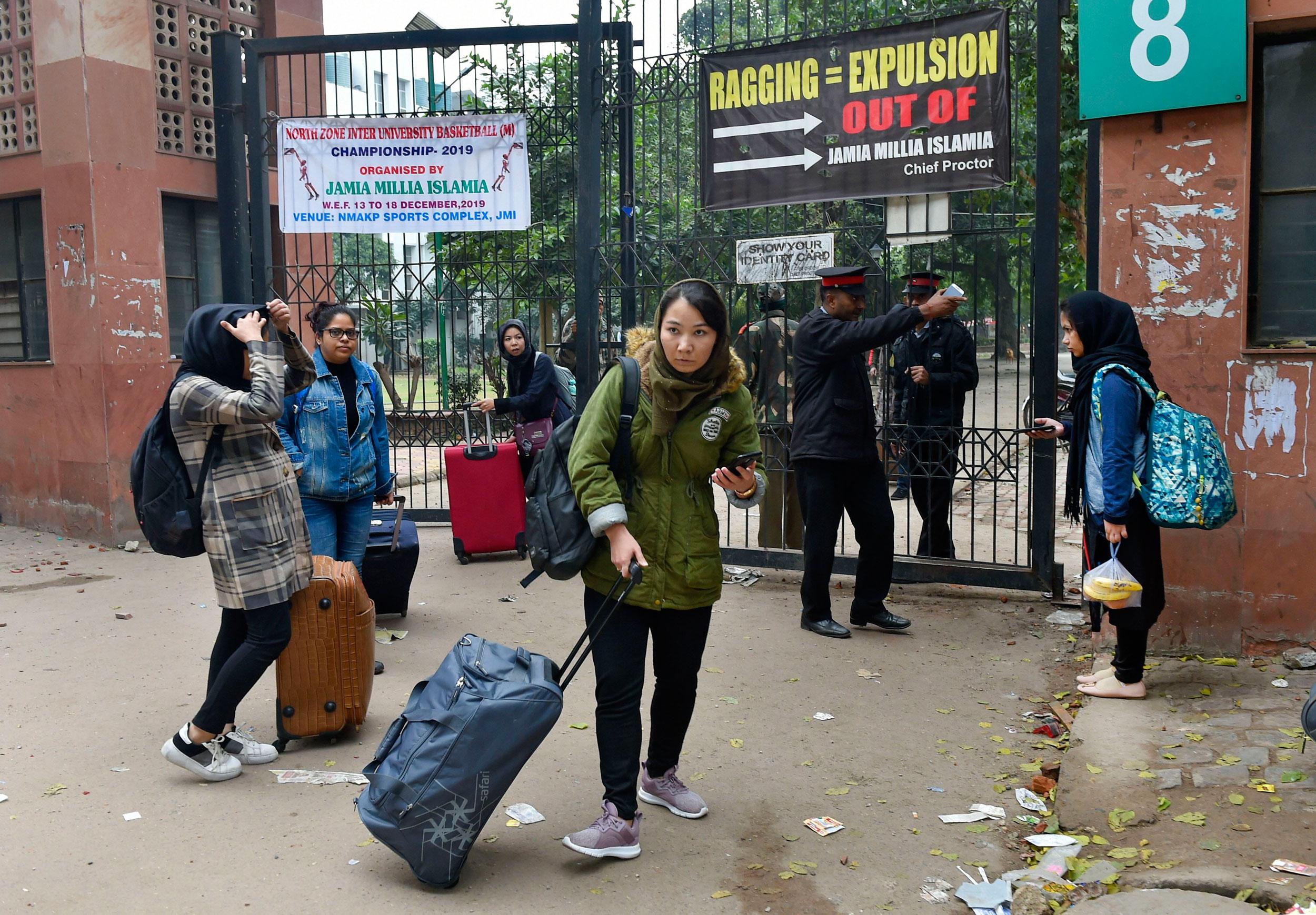 Students leave Jamia Millia Islamia campus in New Delhi on Monday.