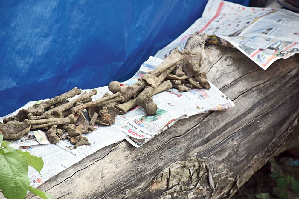 Bones and parts of a human skull recovered from the site at Sikandarpur on Wednesday