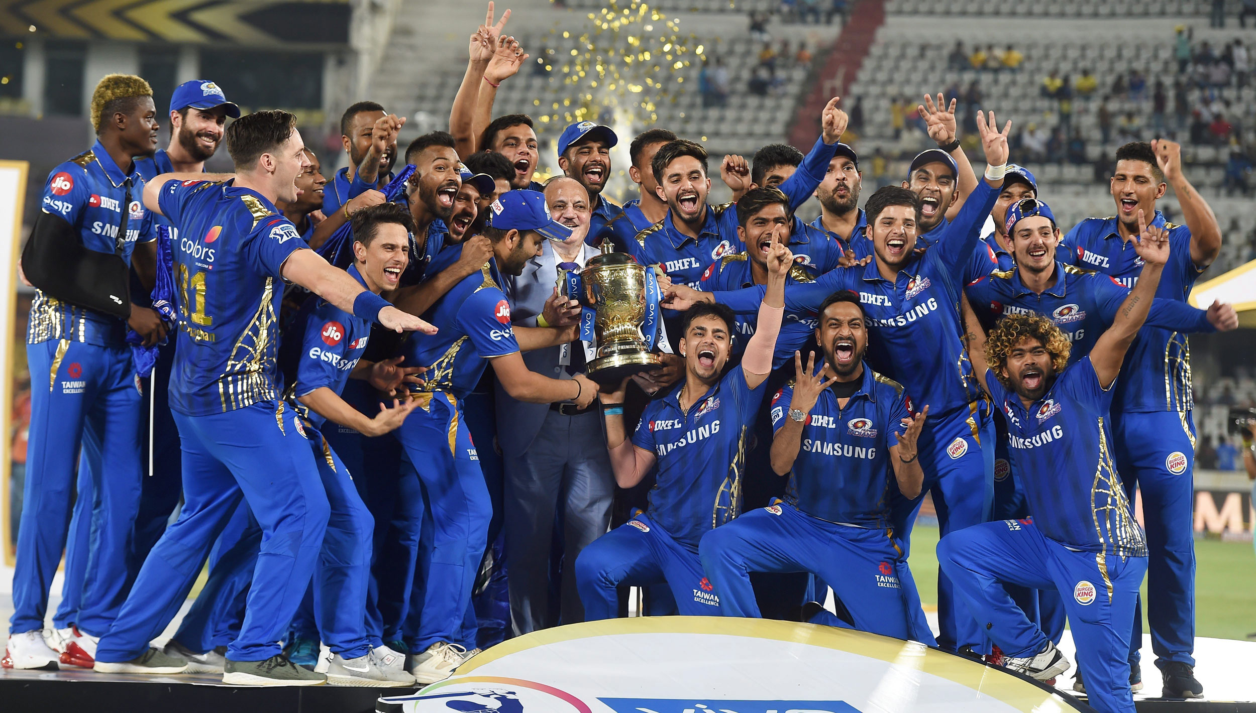 Mumbai Indians players celebrate with the IPL trophy after winning the finals against Chennai Super Kings, in Hyderabad, on May 13, 2019.