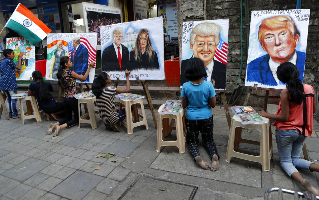 Children from an art school make paintings of U.S. President Donald Trump ahead of his India visit, in Mumbai