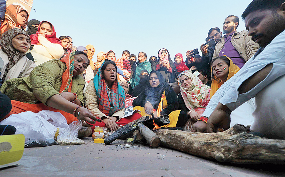 Women perform a havan at the protest against the CAA at the Ghanta Ghar in Lucknow on Wednesday