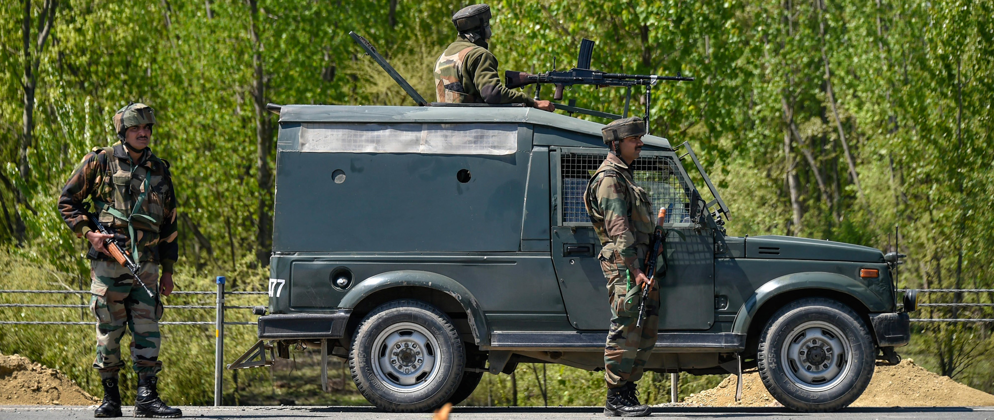 Army personnel stand guard on the Jammu-Srinagar-Baramulla national highway, on the outskirts of Srinagar on Wednesday, April 10, 2019. The closure of the arterial road twice a week during elections is being seen as the treatment of Kashmir as a colony