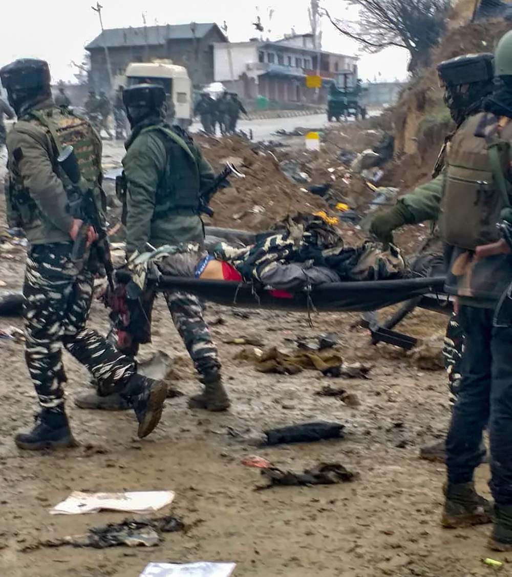 Jawans carry a victim after militants attacked their CRPF convoy in Pulwama on Februrary 14.