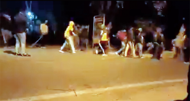 Footage shows some of the attackers walking away with impunity as policemen (left) watch