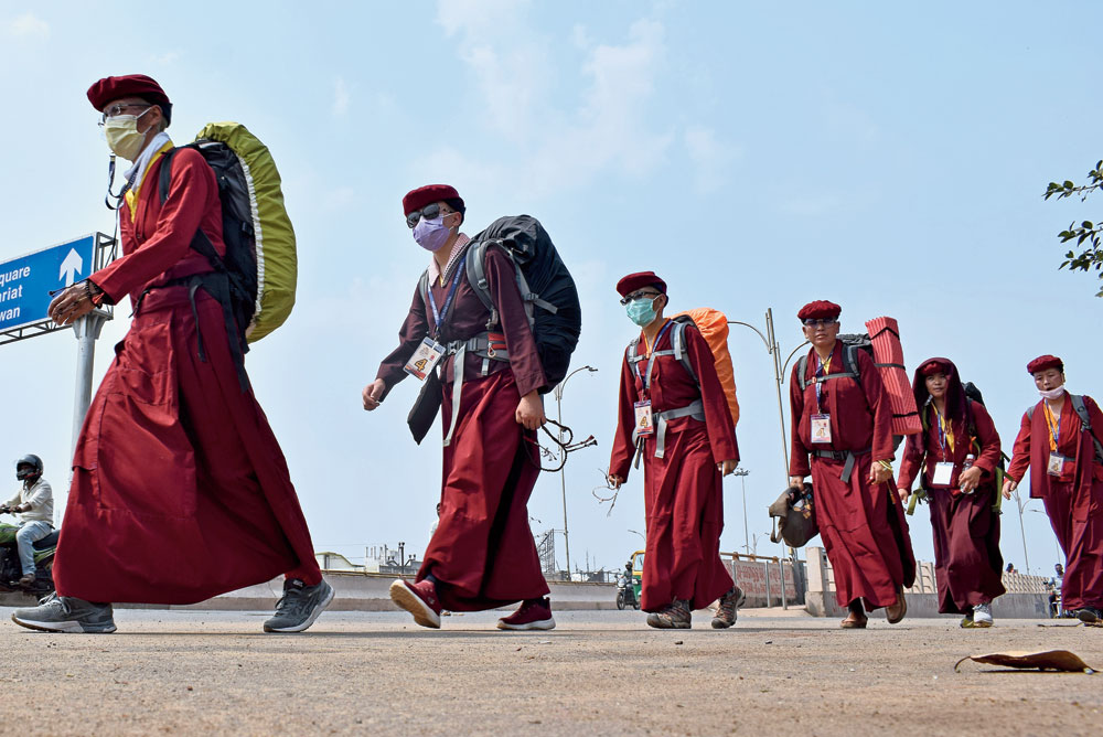 Walk with a message: Buddhist monks and nuns near the Dhauli Peace Pagoda in Bhubaneswar on Wednesday.