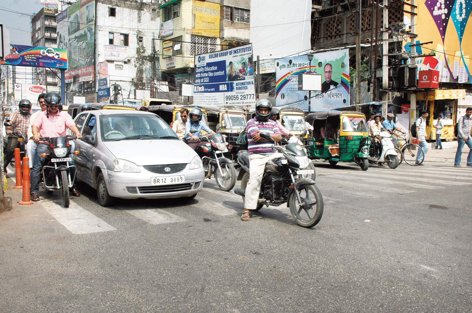 Vehicles violate zebra crossing rules at a city junction