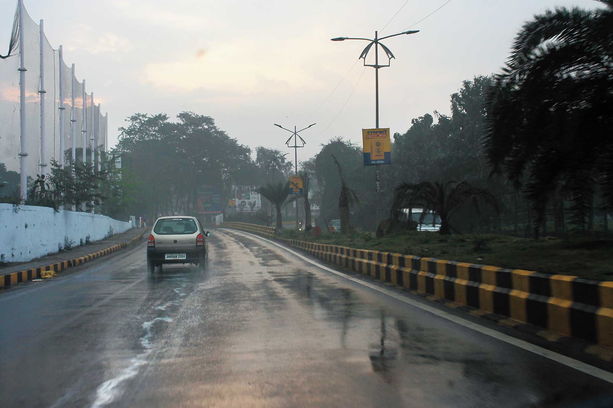 A rain-soaked Golmuri-Telco road in Jamshedpur on Monday.