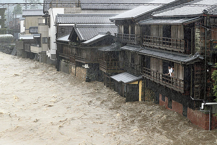 A man watches the swollen Isuzu river in Ise, central Japan, on Saturday after Typhoon Hagibis made landfall.