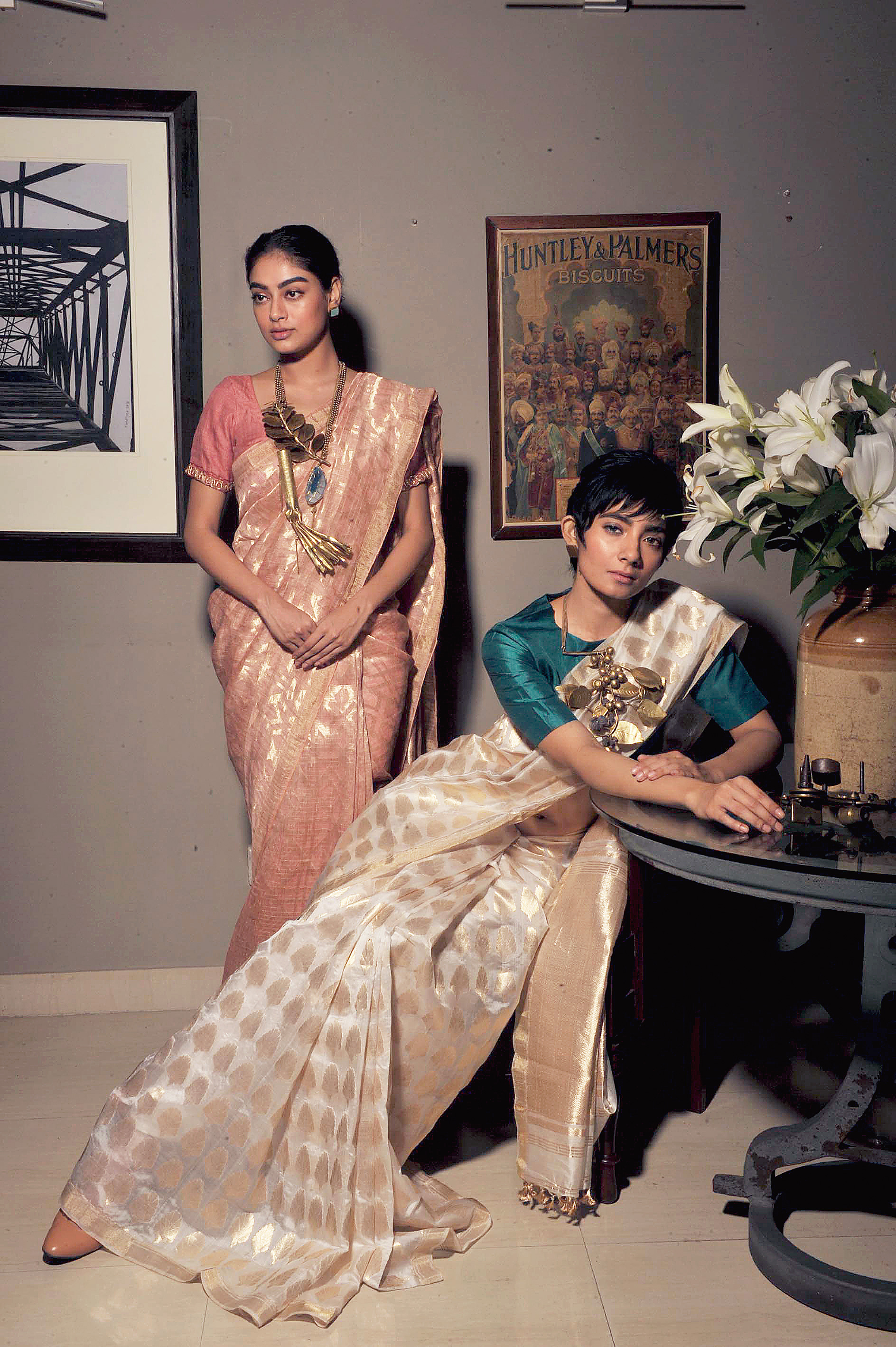 Soumitra gave Sneha a white silk sari with a plain silk blouse and Narayan hung a foliage-inspired brass-copper piece around her neck with studs for her ears. Barely-there make-up added to the radiant charm. Bibriti's hair was tied up in a bun as she draped a peach linen-silk sari by Soumitra. Narayan dressed her up with a statement neckpiece, again from the foliage family. The quirk factor? Elements like bicycle tyre tubes and nozzles