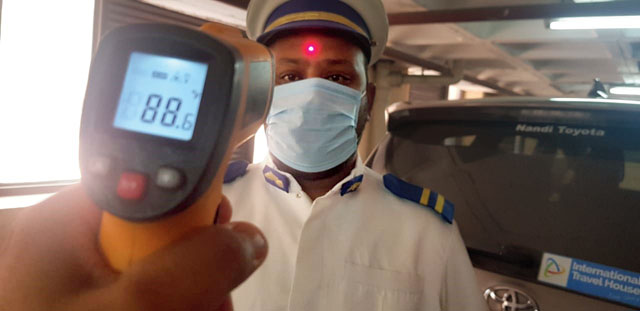 Temperature check of staff being conducted at ITC Hotels