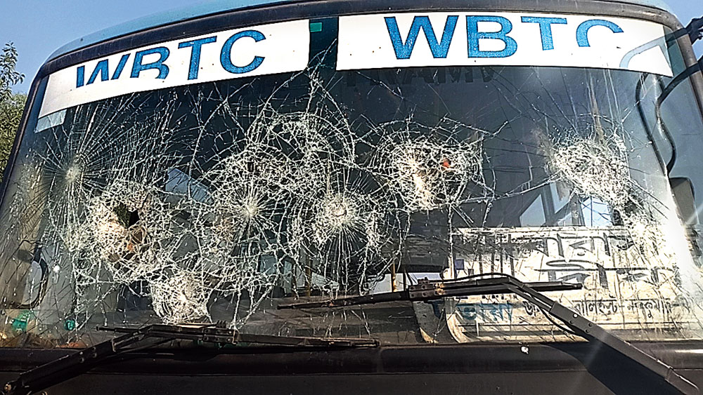 A bus ransacked in Contai during the clash on Tuesday.