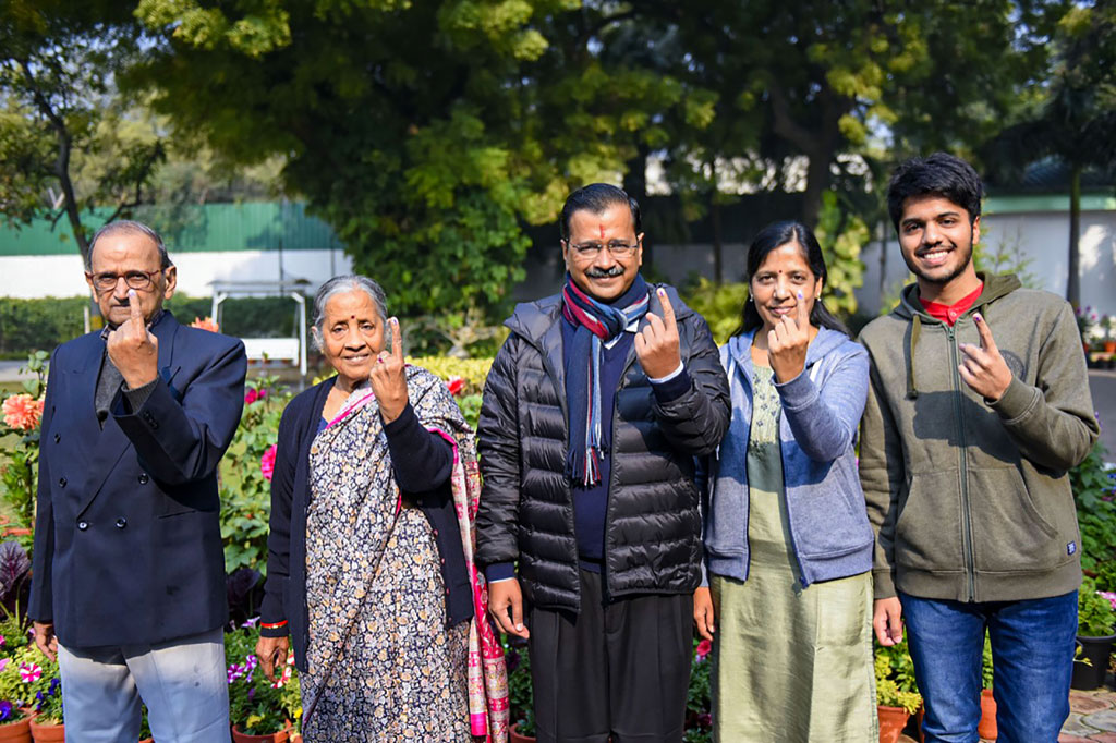 Delhi Chief Minister and AAP convenor Arvind Kejriwal and his family members show their finger marked with indelible ink after casting vote during the Delhi Assembly elections at a polling station, in Civil Line area of New Delhi